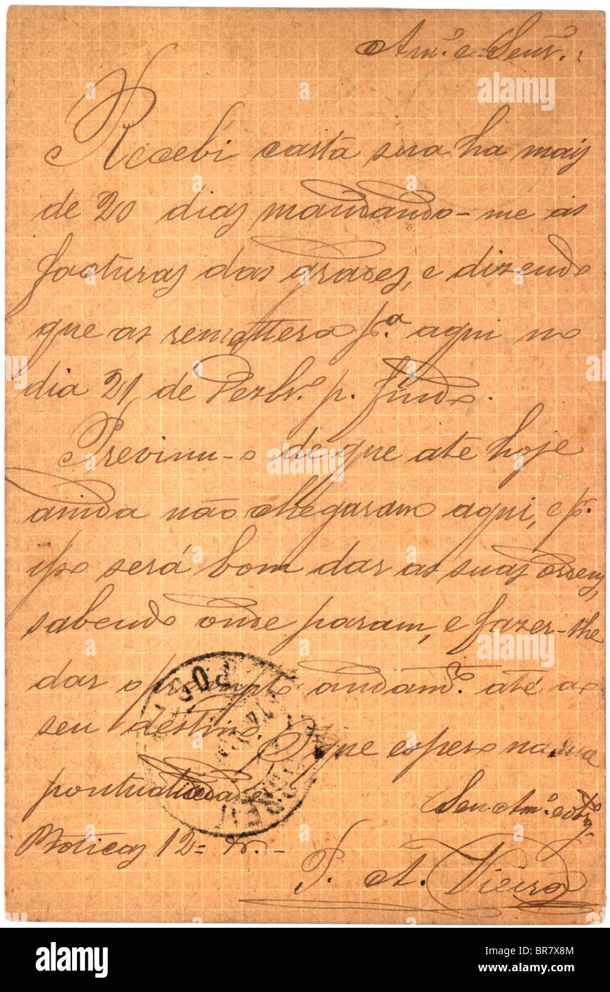 Vintage postcard with script writing and postmark - Stock Image