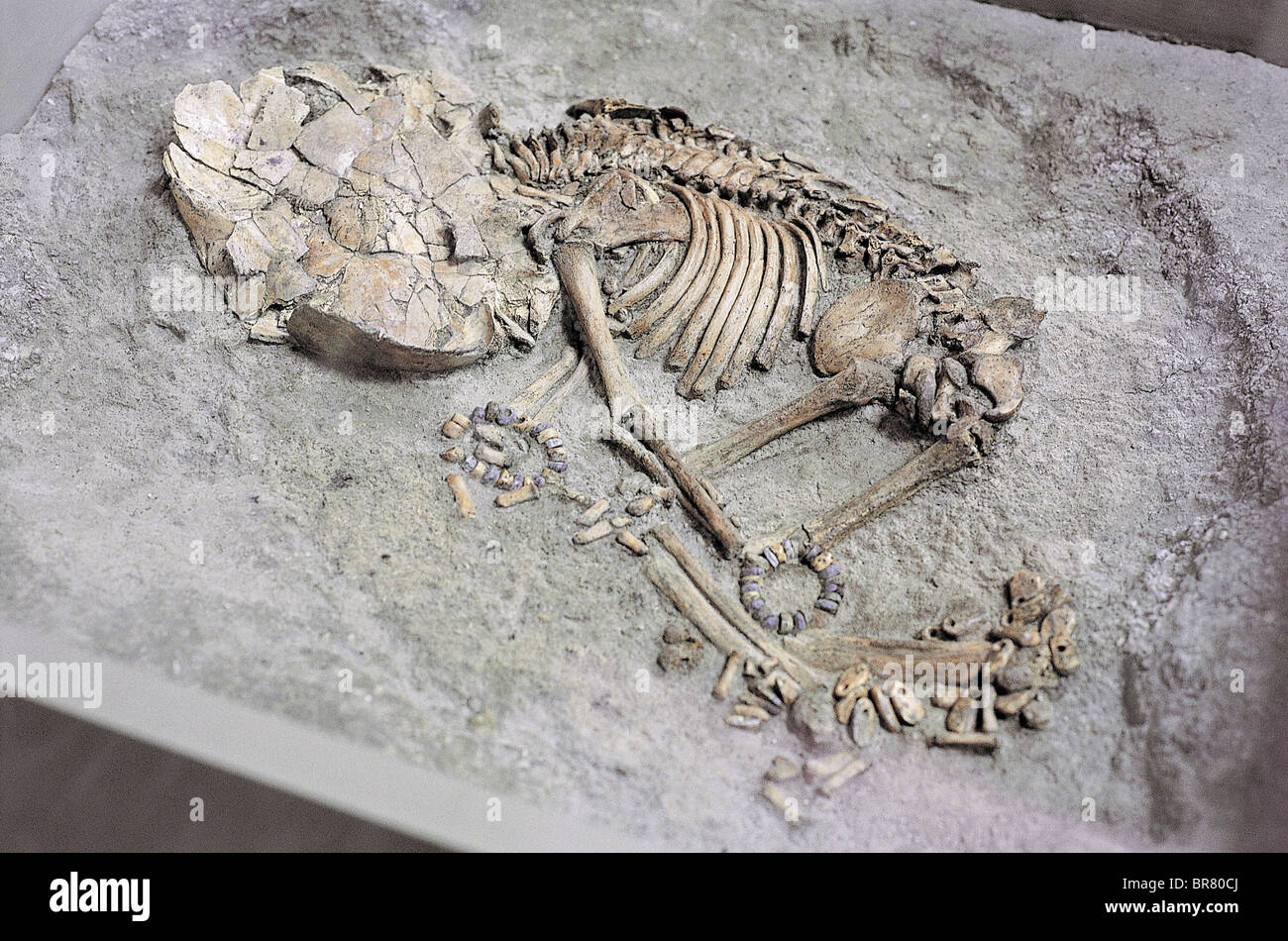 Child burial with necklaces and ornaments in Catalhoyuk Turkey - Stock Image