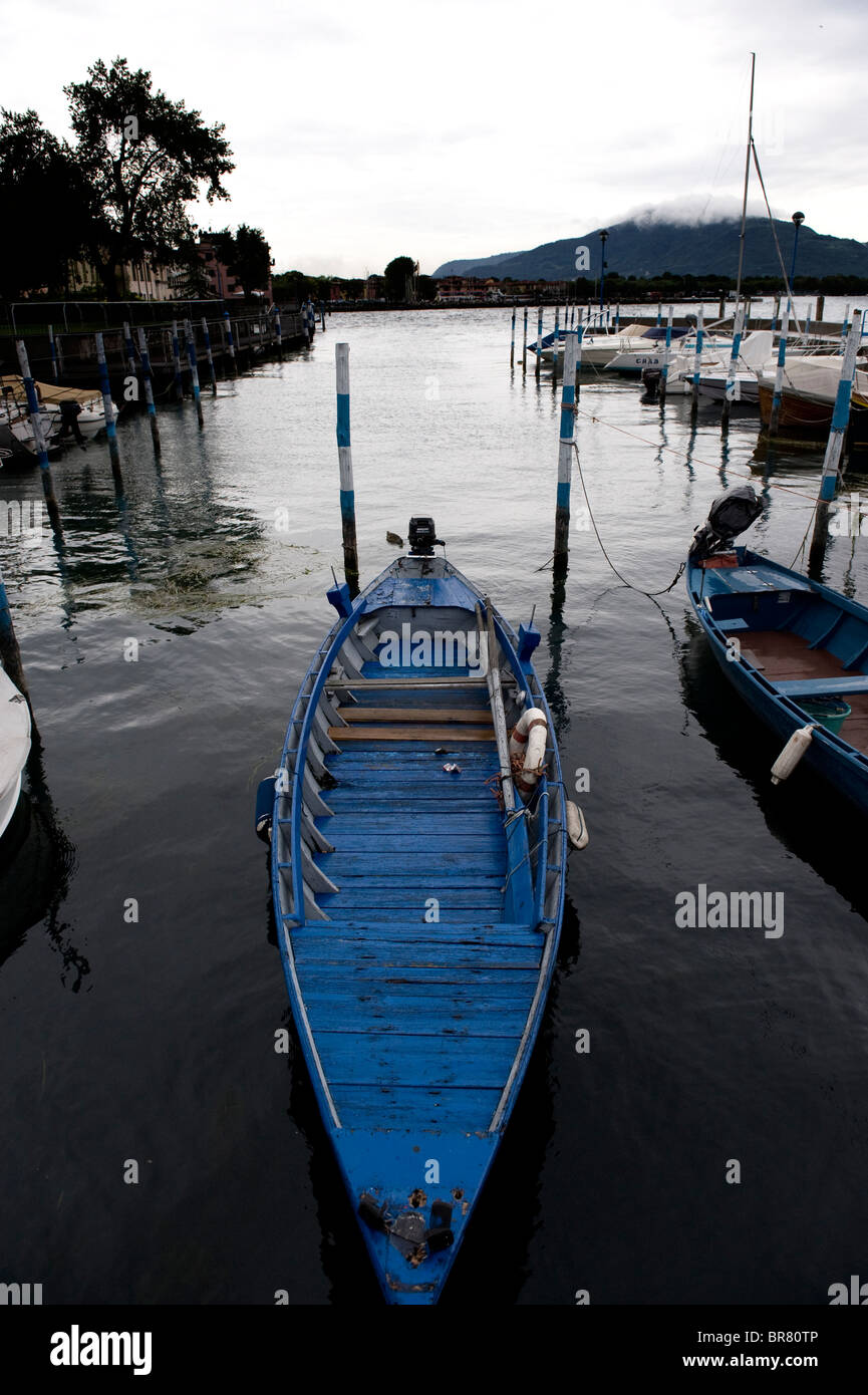 Boat tied up in Iseo, Lake Iseo, northern Italy. - Stock Image