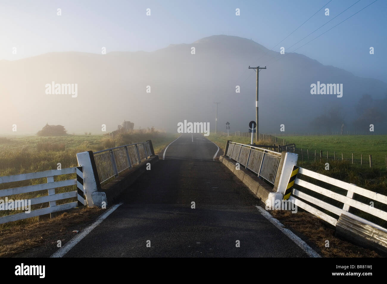 A misty road bridge in Tolaga Bay on the East Cape, New Zealand. - Stock Image