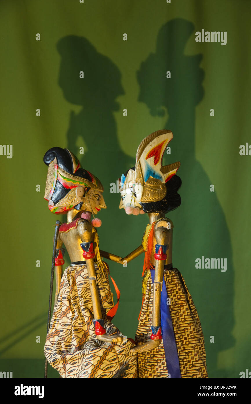 Two Shadow Puppets with shadows known as Wayang Kulit - Stock Image