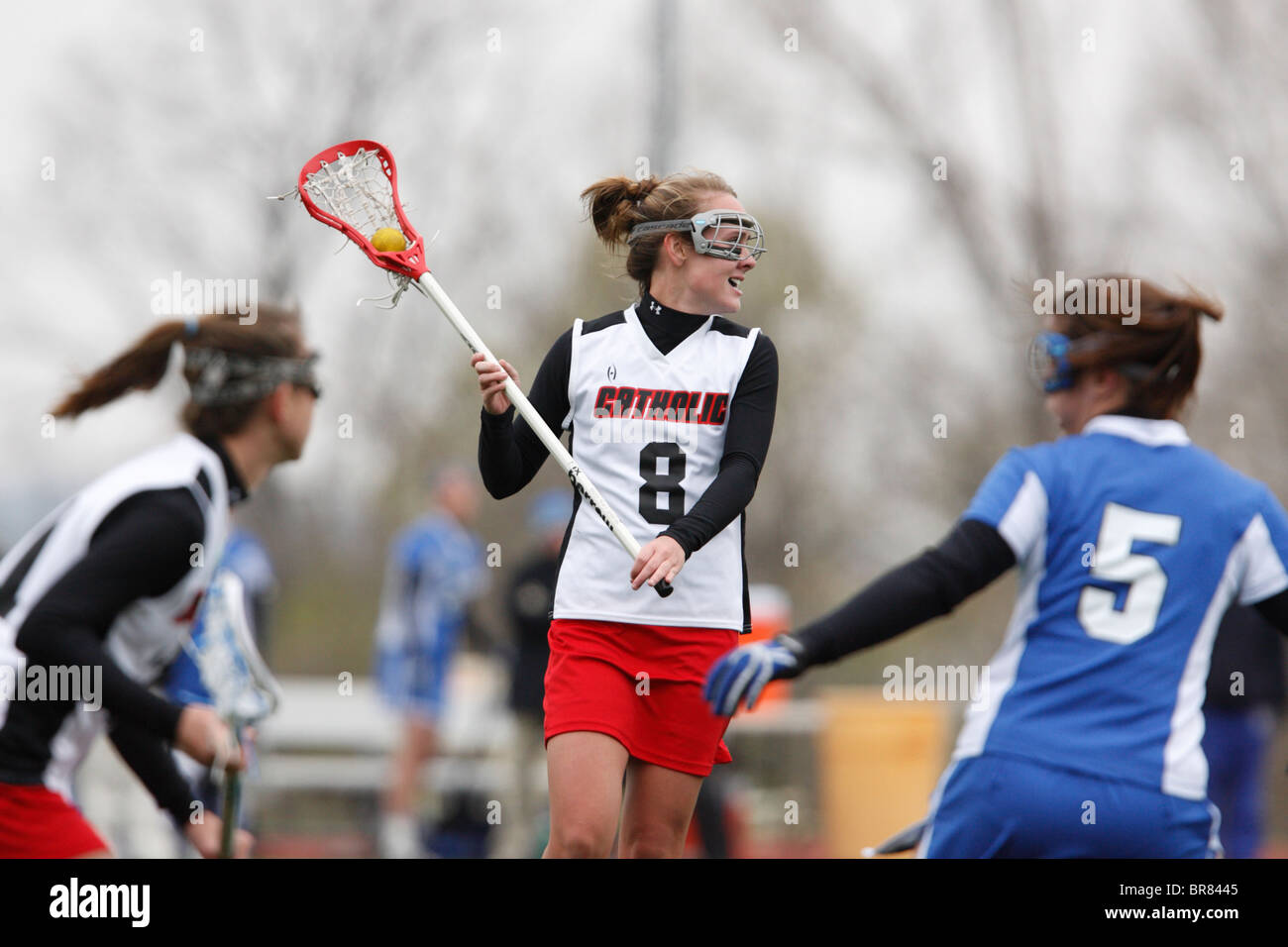 A Catholic University player looks to take a shot against Marymount University during a college lacrosse game April - Stock Image
