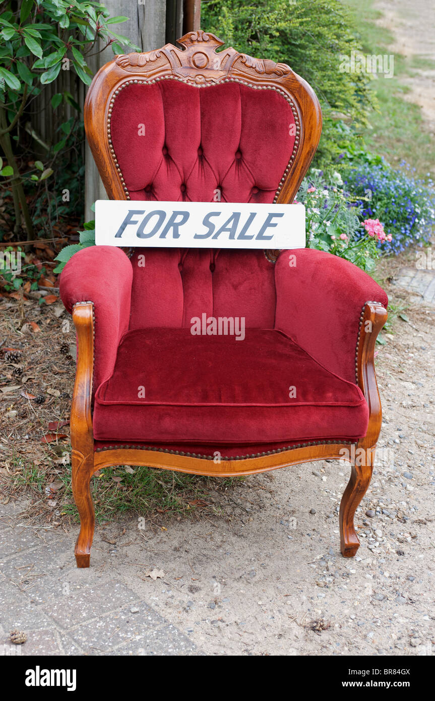 Secondhand chair for sale outside a house in Suffolk, UK. - Stock Image