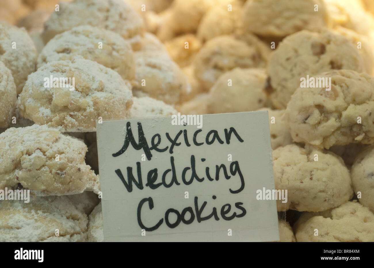 traditional mexican wedding cookies on display at a bakery on linden