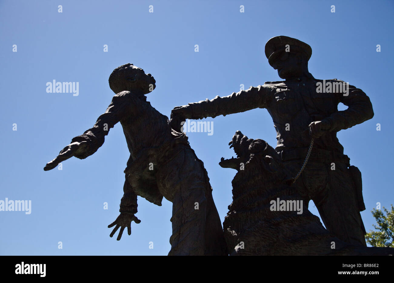 A statue depicting police brutality during the Civil Rights Movement at Kelley Ingram Park in Birmingham, Alabama - Stock Image