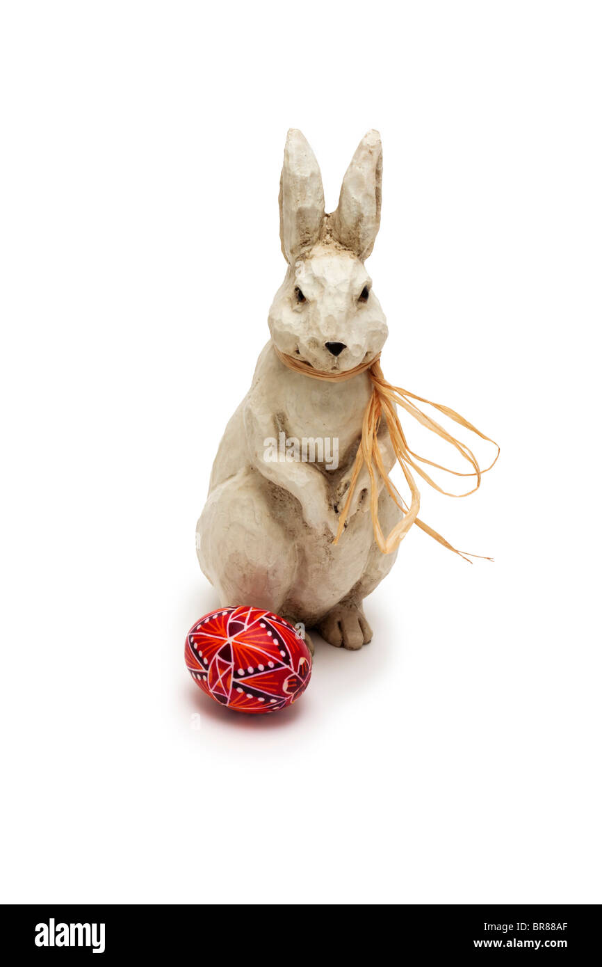 Easter bunny with a painted egg Stock Photo