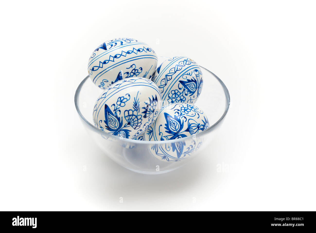 Hand painted blue and white traditional Easter Eggs in a glass bowl Stock Photo