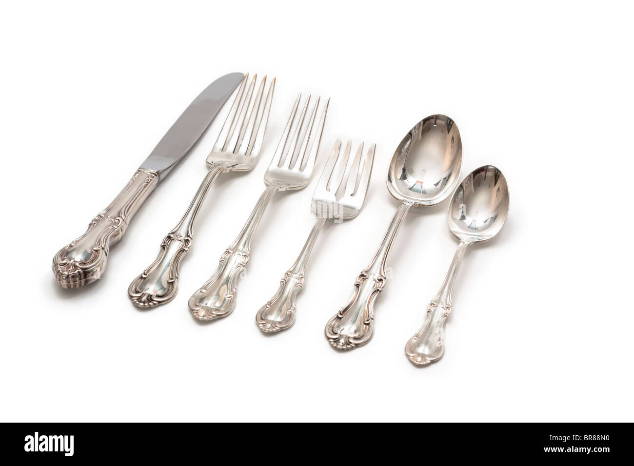 Silver flatware, knife, forks, and spoons - Stock Image