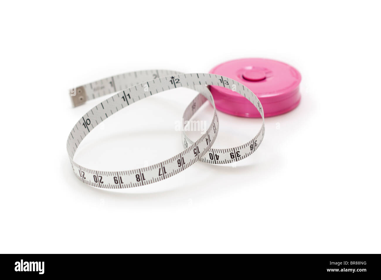 Tape measure with inches and centimeters Stock Photo