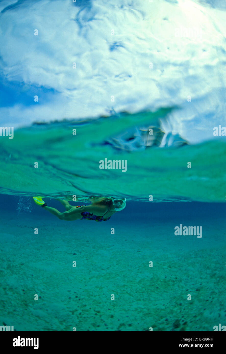 Woman Snorkeling In The Turquoise Waters Of Belize Cayes