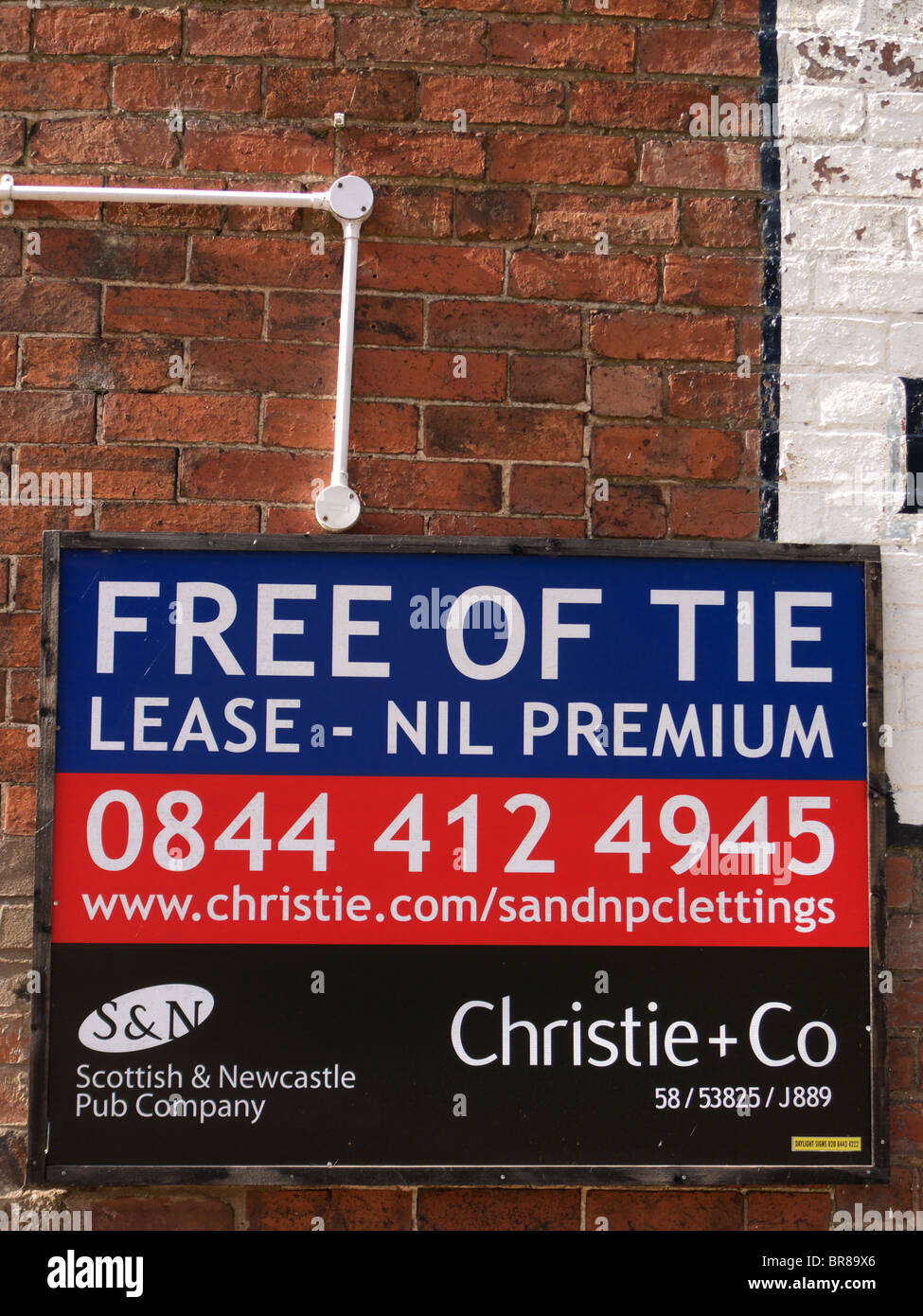 Commercial To Let Sign for a Public House fixed to a Wall, UK - Stock Image
