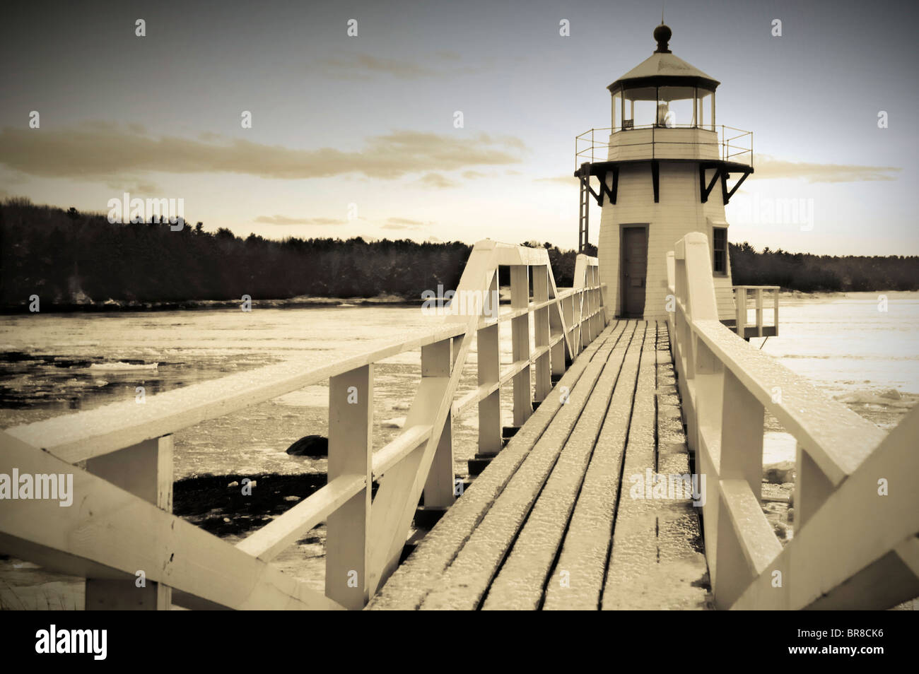 Doubling Point Lighthouse on the Kennebec river near Bath Maine in the winter. (sepia) (vignette) - Stock Image