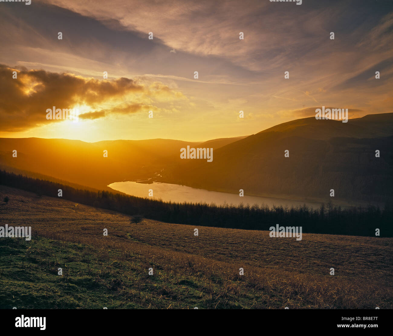 TALYBONT RESERVOIR BRECON BEACONS AT SUN SET - Stock Image