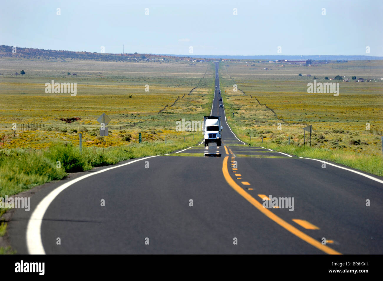 Long straight roads in desert country Arizona USA - Stock Image