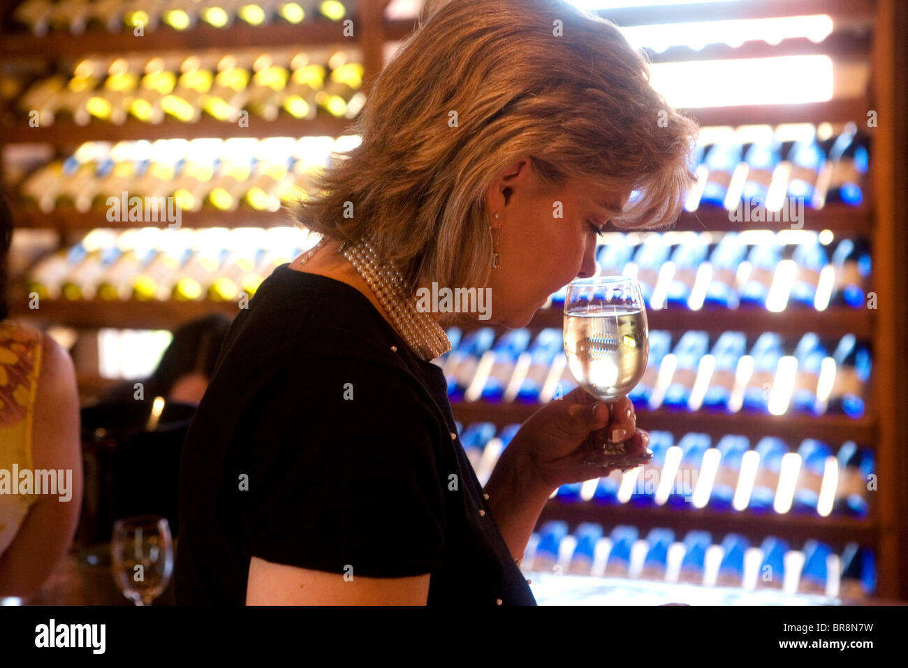 A woman tastes wine in Charlottesville VA. - Stock Image