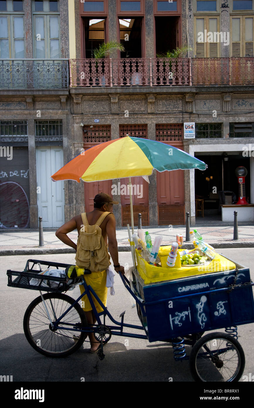 Brazillian man selling drinks at the Saturday morning market in the Lapa area of Rio - Stock Image