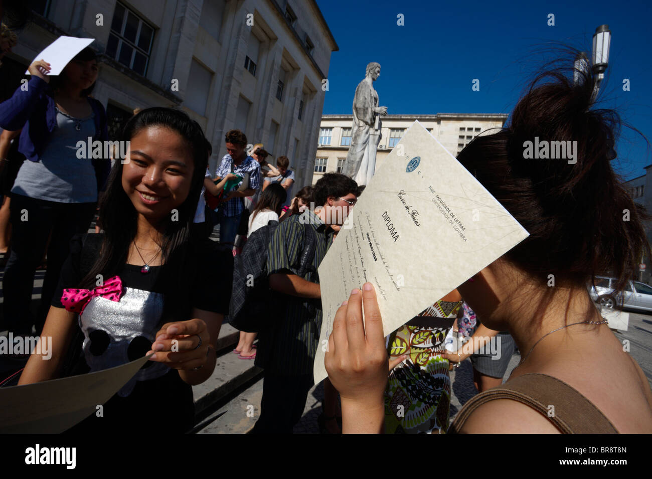 Foreign exchange students at the University of Coimbra after receiving diplomas for completing the Portuguese language Stock Photo