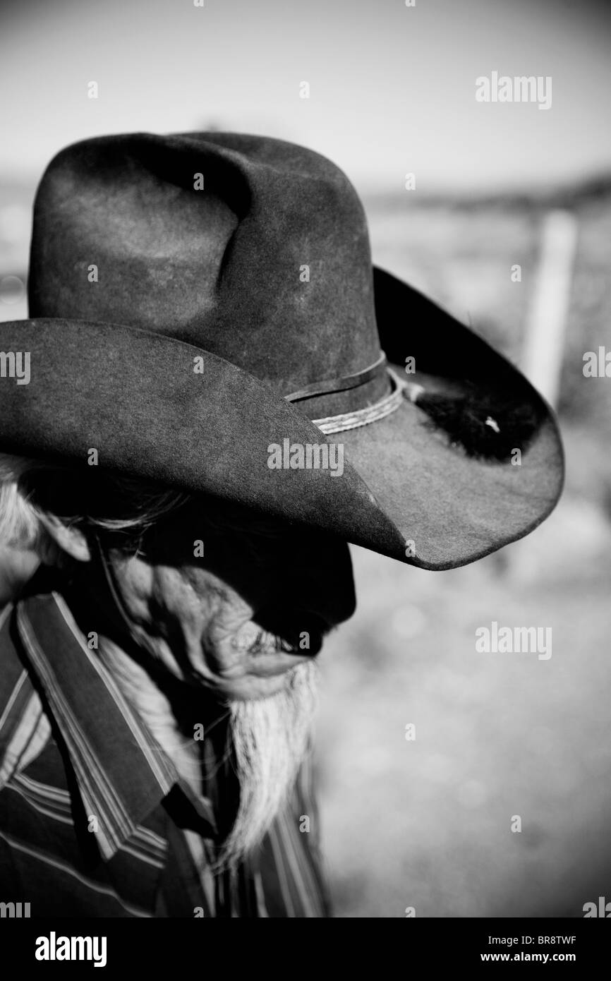 390a6f3c7a5 A black and white image of an older Latin American man wearing a cowboy hat.