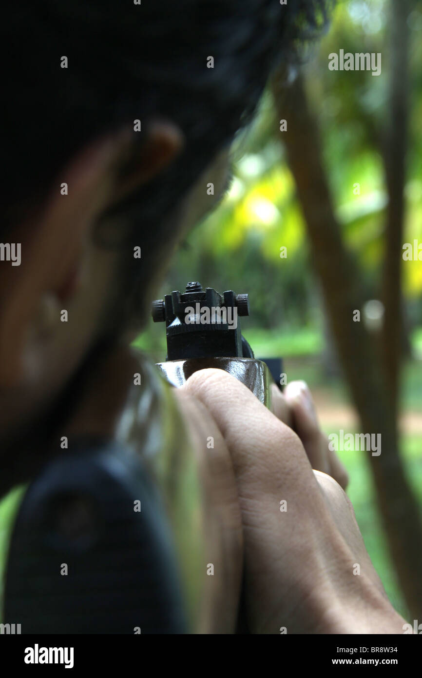 Gunman aiming to trigger - Stock Image