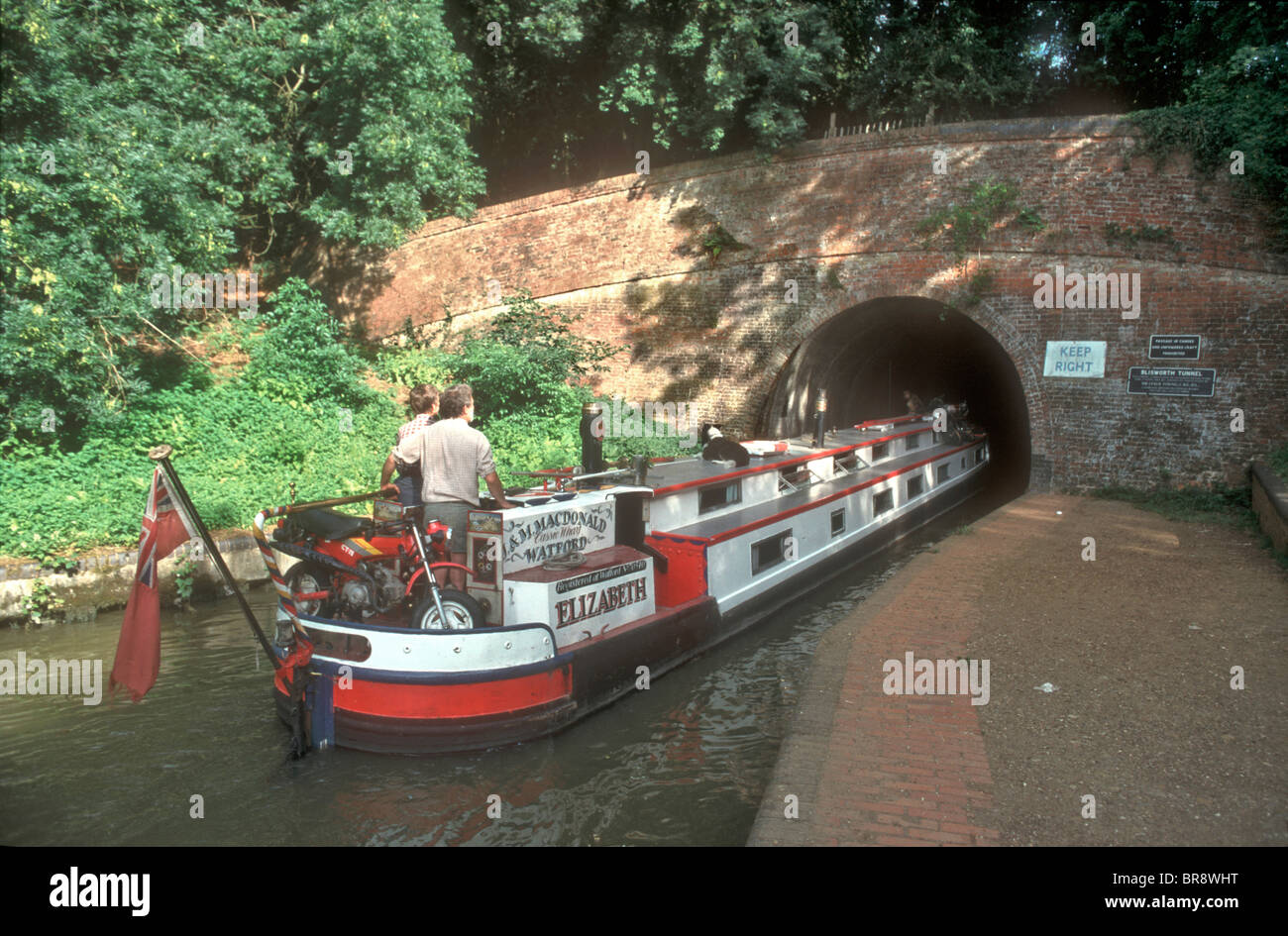 1936 narrowboat to houseboat conversion at Grand Union Canal at Blisworth Tunnel Stoke Bruerne Northamptonshire - Stock Image