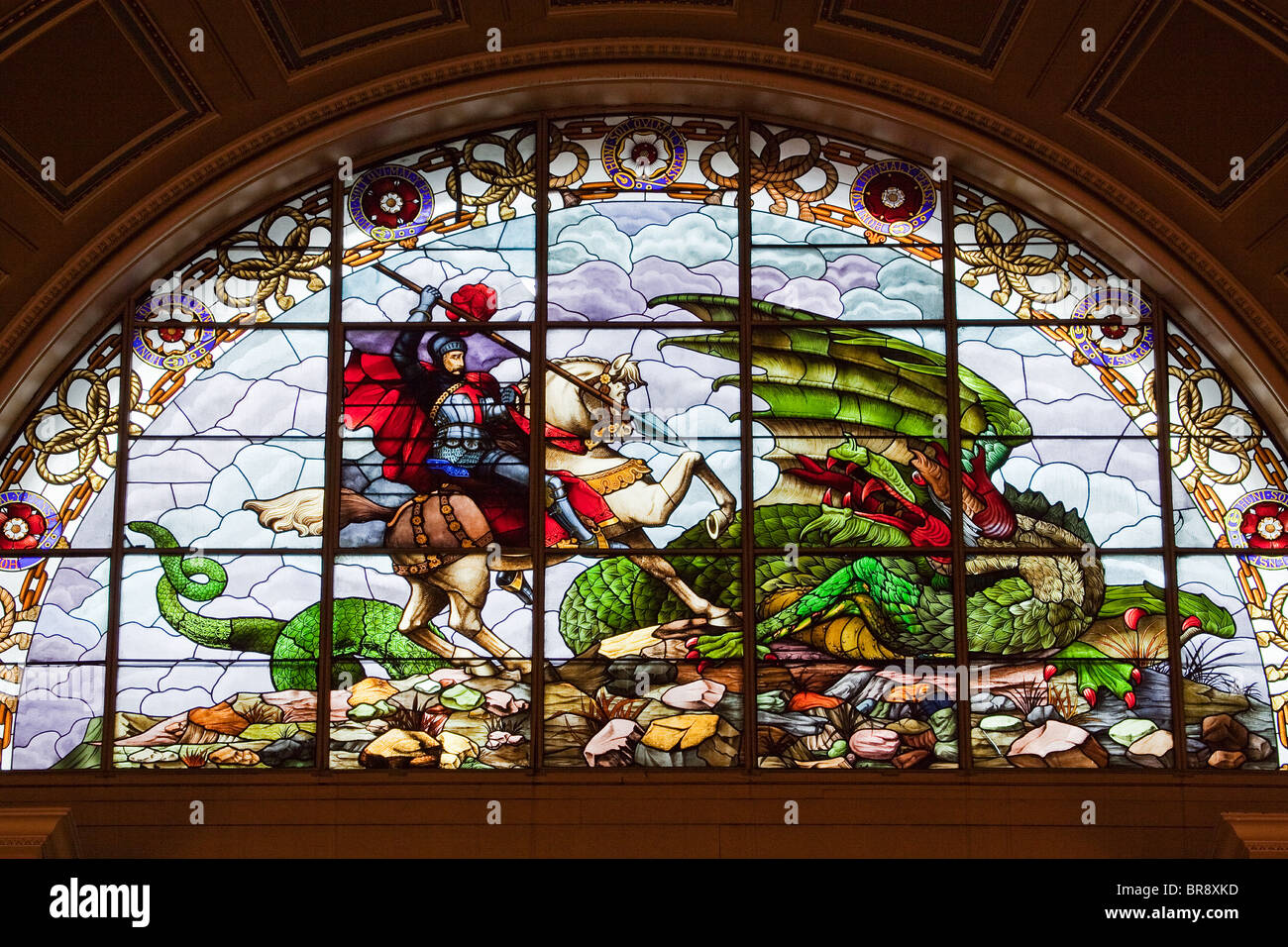 Stained glass windows showing St George and the Dragon, in ...