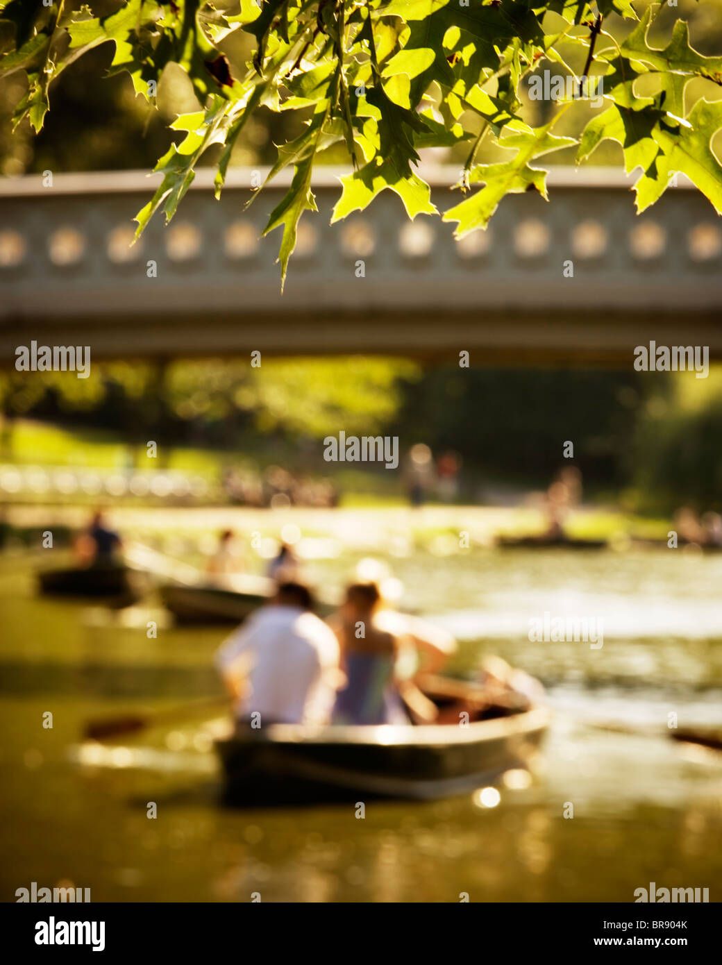 Row boats on the water Bow Bridge Central Park Manhattan NYC - Stock Image