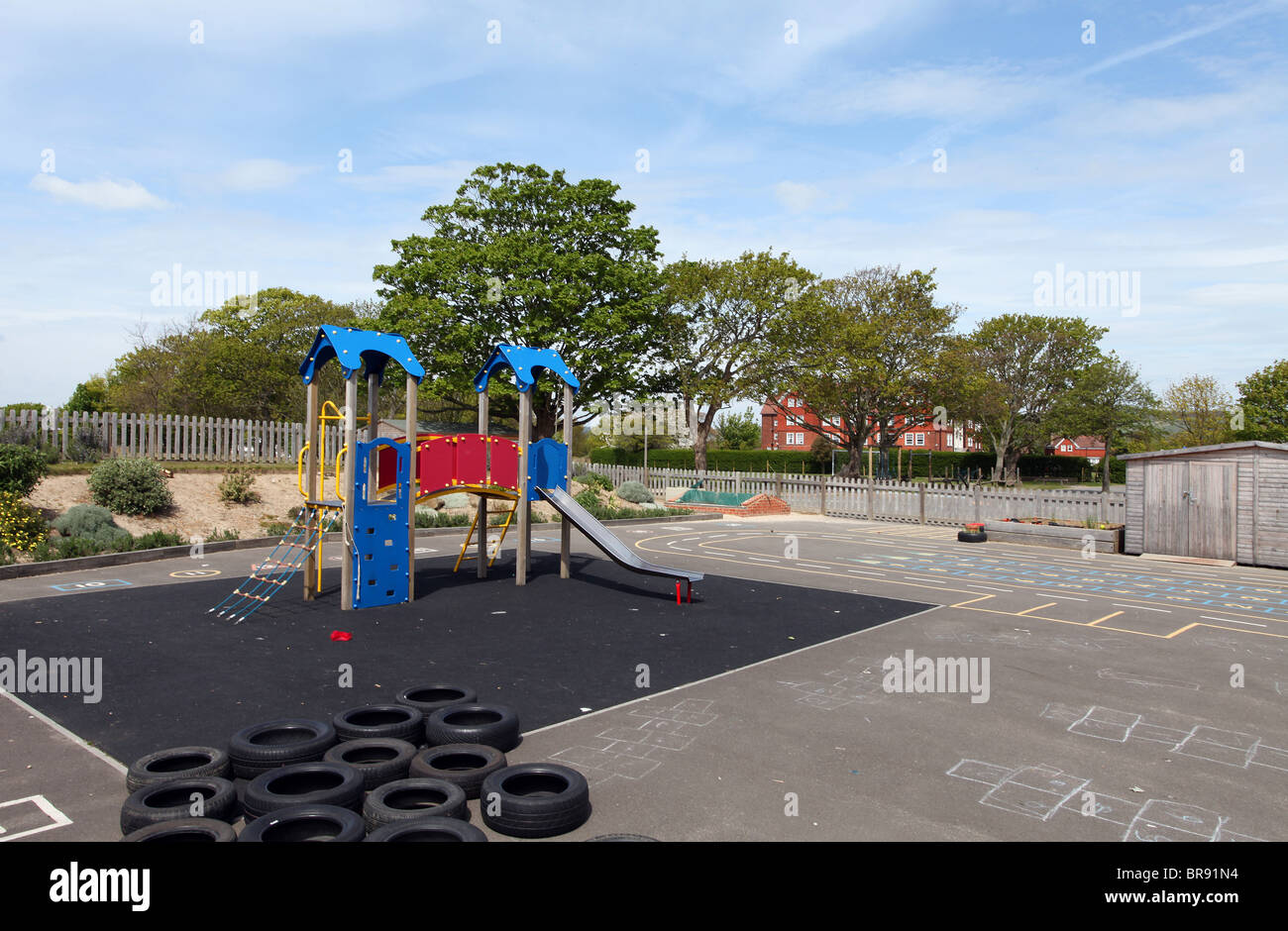 School yard playground at a UK infant/junior school ages 5 - 11 years - Stock Image