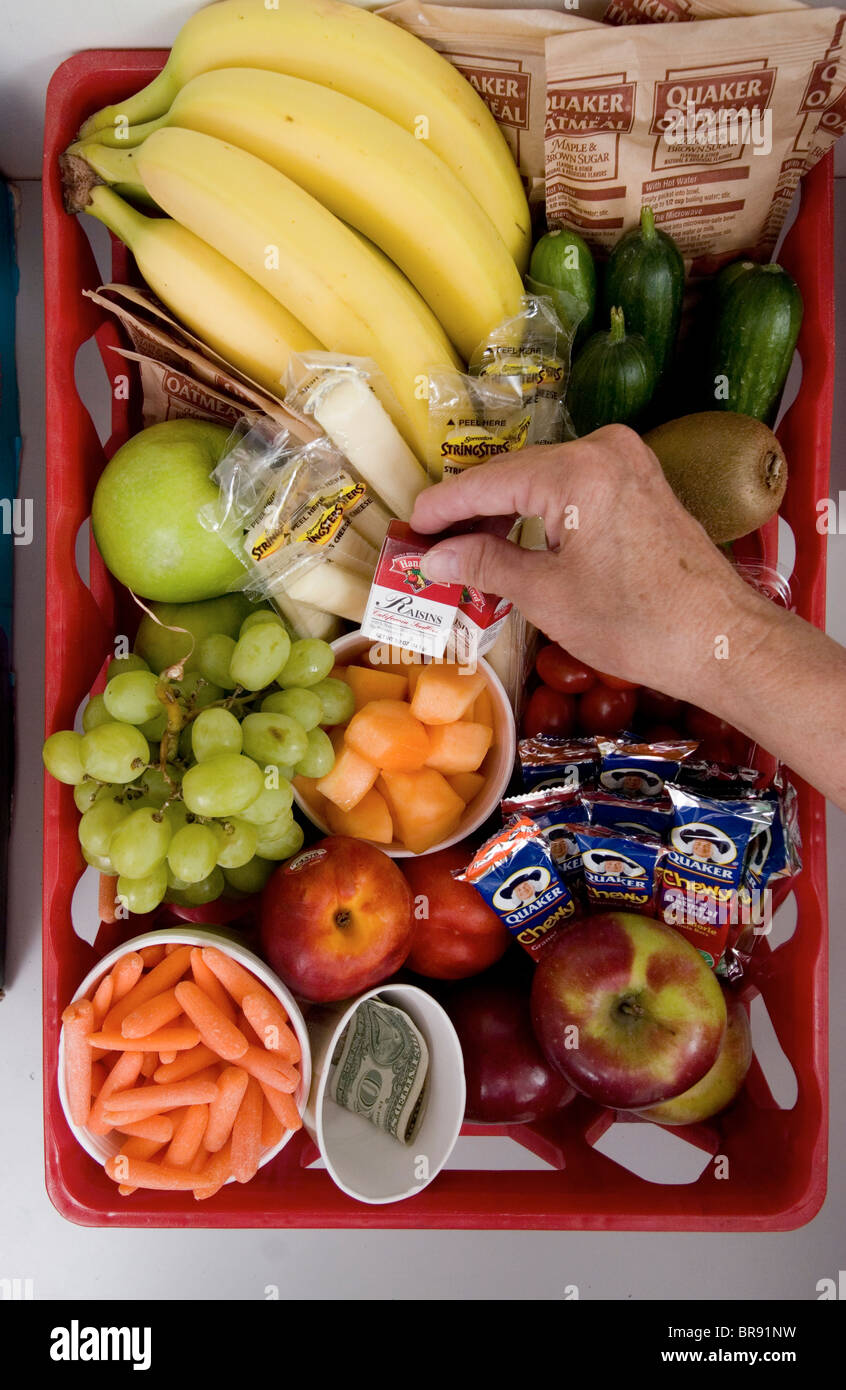 Healthy snacks available in kitchen to The Bangor Letter Shop employees Bangor Maine. - Stock Image