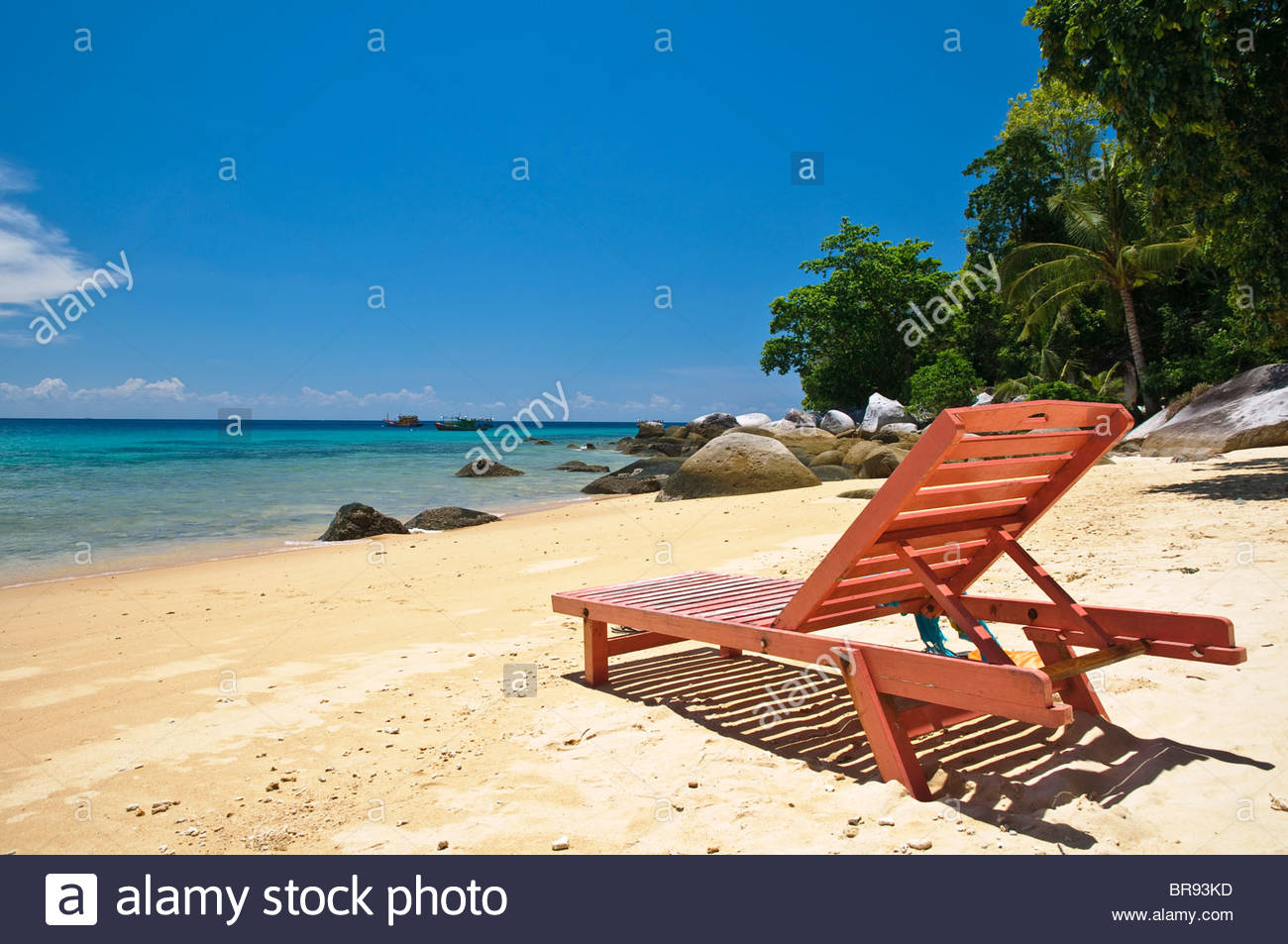 Red beach chair on the beach of Panuba, Pulau Tioman Island, Malaysia, Southeast Asia, Asia Stock Photo