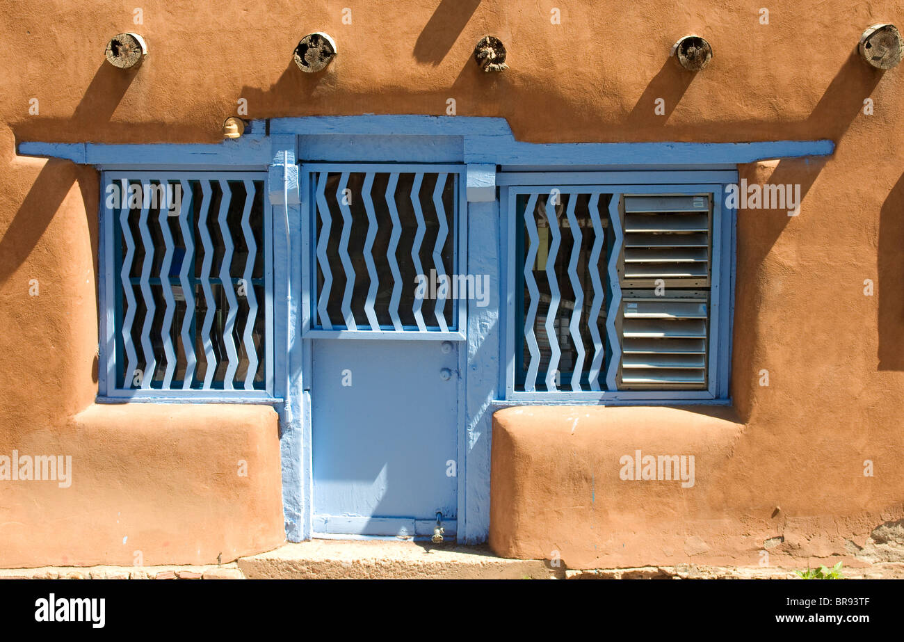 Adobe Restaurant With Turquoise Painted Doors And Windows