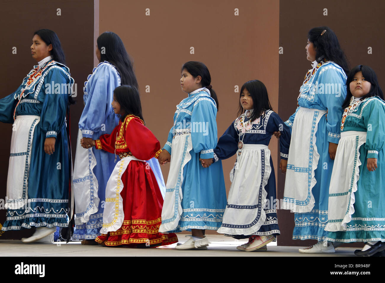 Cherokee, North Carolina -  Chactaw Indians women and girls performing a social dance on stage. - Stock Image