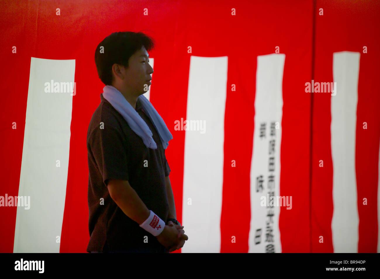 A Japanese man waiting for the Kishiwada Danjiri Matsuri festival to begin in the city of Osaka Japan (intentional - Stock Image