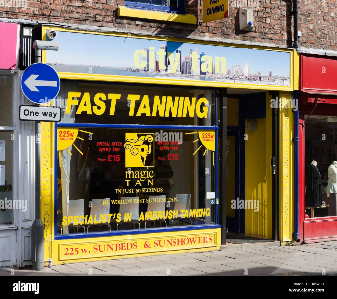 High street tanning salon, Chester, Cheshire, England, UK - Stock Image