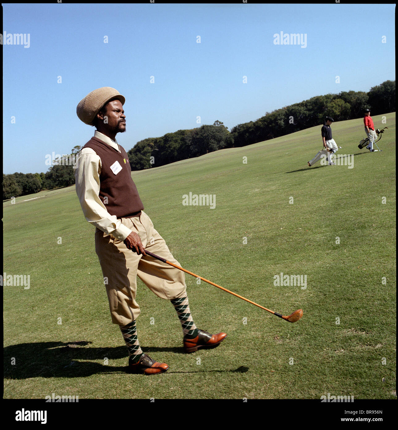 Playing Retro Golf with Hickory Clubs - Stock Image