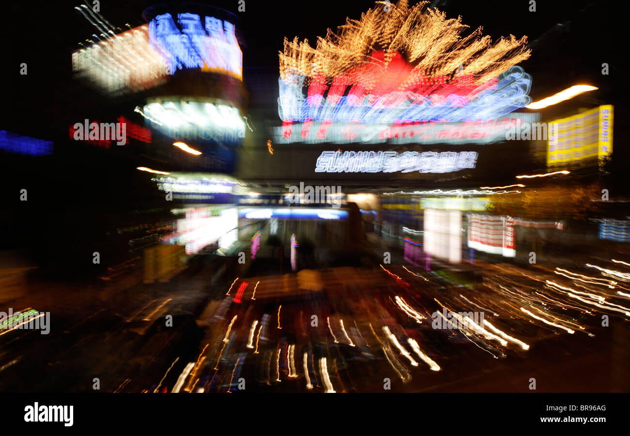 A zoom blur of colorful city lights at night in Hangzhou, China. - Stock Image