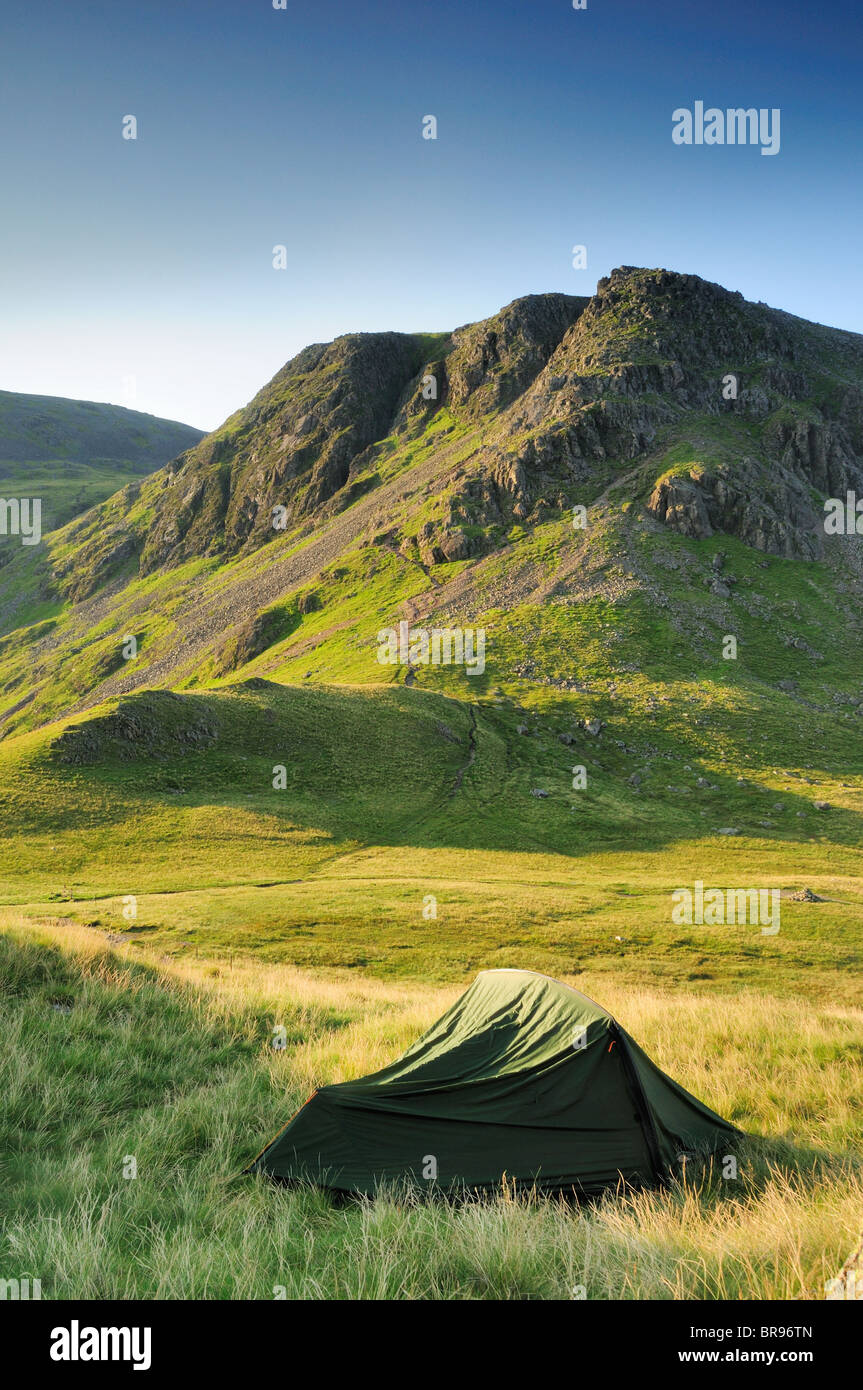 Wild camping on Black Sail Pass in the English Lake District. Kirk Fell is the mountain in the background. - Stock Image