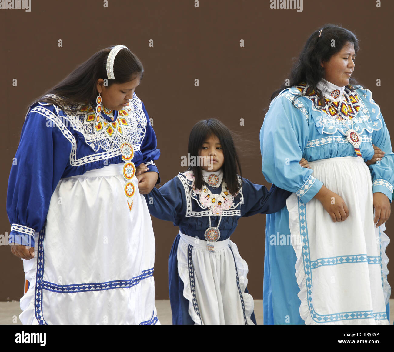 Cherokee, North Carolina -  Chactaw Indians women and a girl performing a social dance. - Stock Image