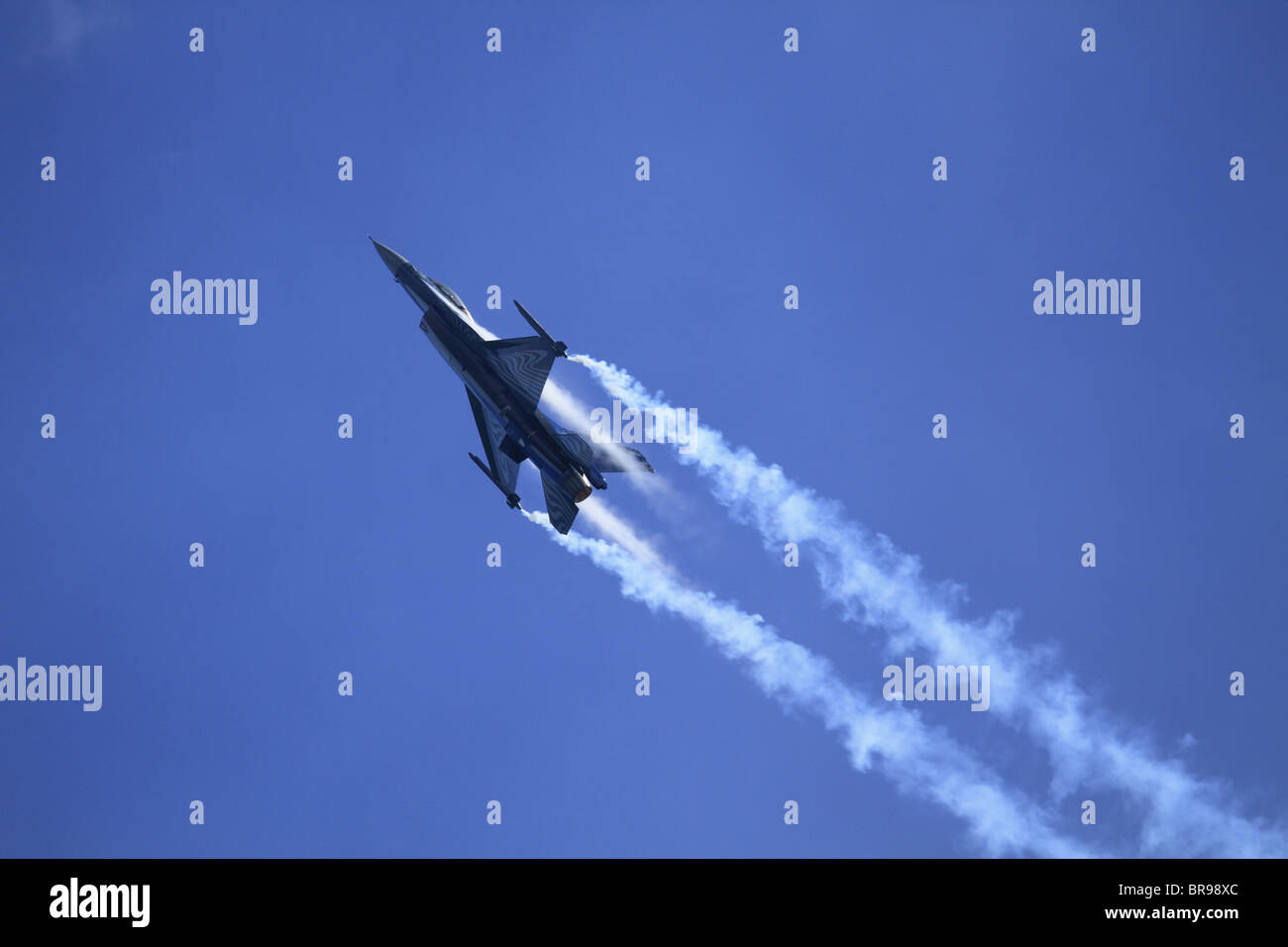 A Belgian Air Force F16 (Lockheed Martin F-16 Fighting Falcon) Fighter Jet performs at Eastbourne Air Show, East - Stock Image