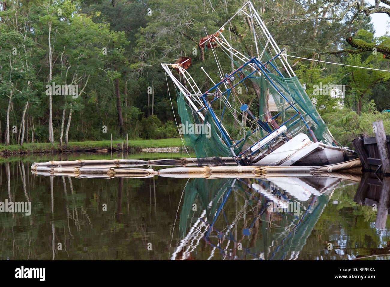 Half sunken, scuttled shrimp fishing boat in the bayou of Bayou La Batre - Stock Image