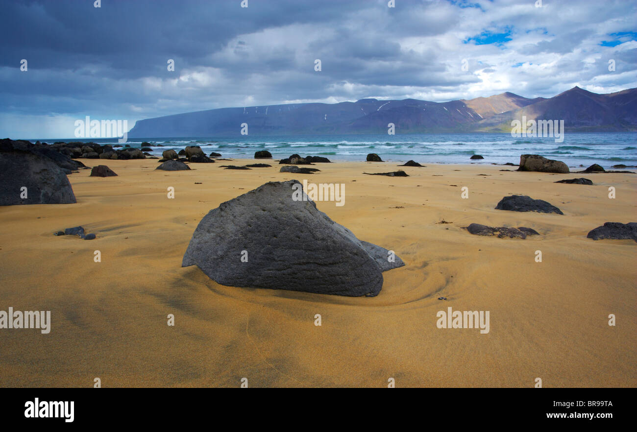 A view across Arnarfjordur from a beach along the Selardalur Route in the West Fjords of Iceland, Vestfirdir Region - Stock Image
