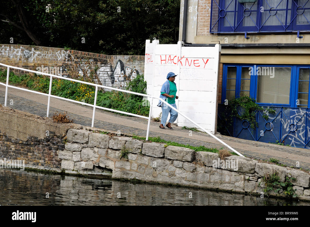 Lady jogging on Regent's Canal Towpath Hackney London England UK - Stock Image