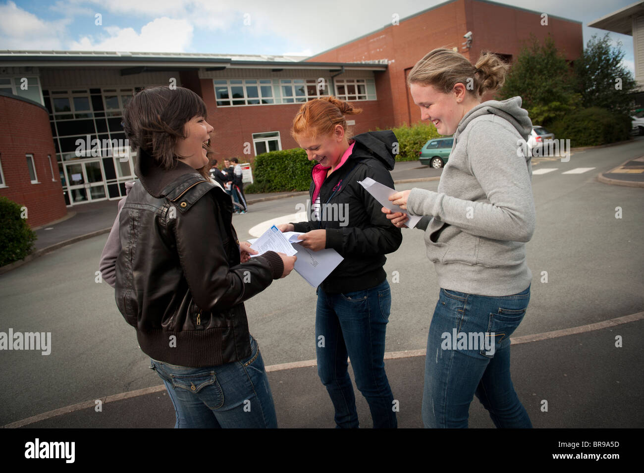 three 16 year old year 8 school children receiving their GCSE exam results, Wales UK - Stock Image