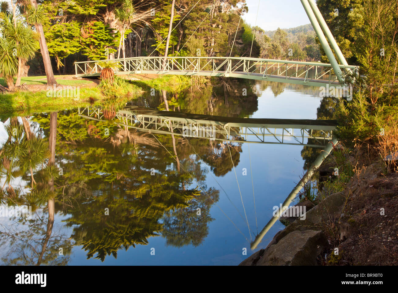 Pedestrian suspension bridge over the Mersey River in Latrobe, northern Tasmania - Stock Image