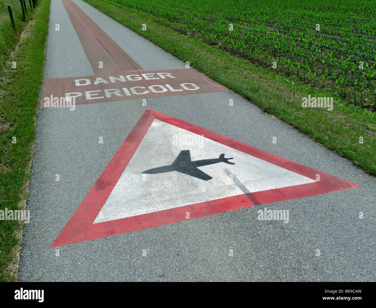 danger warning sign of airplanes flying at low altidude - area of magadino plain - canton of ticino - switzerland - Stock Image