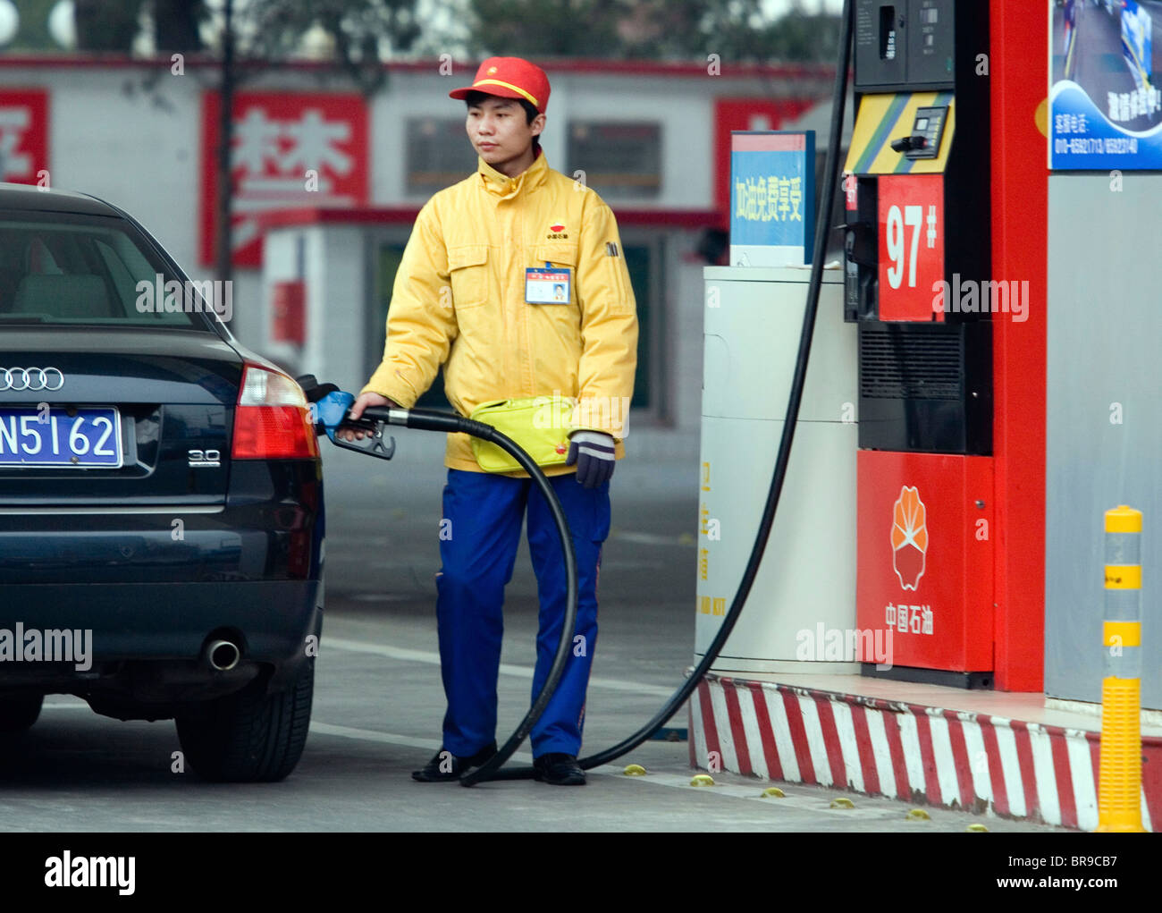 a chinese gas station attendant fills up a customers car in beijing china