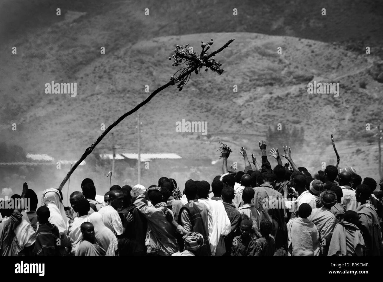 People trying to touch a cross that falls from a bonfire during a Meskel party Sekota Ethiopia. - Stock Image