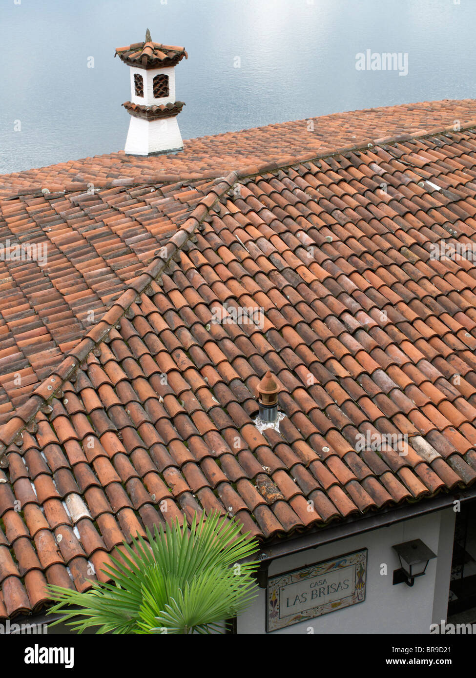roof tiles - view from villa to maggiore lake - canton of ticino - switzerland - Stock Image