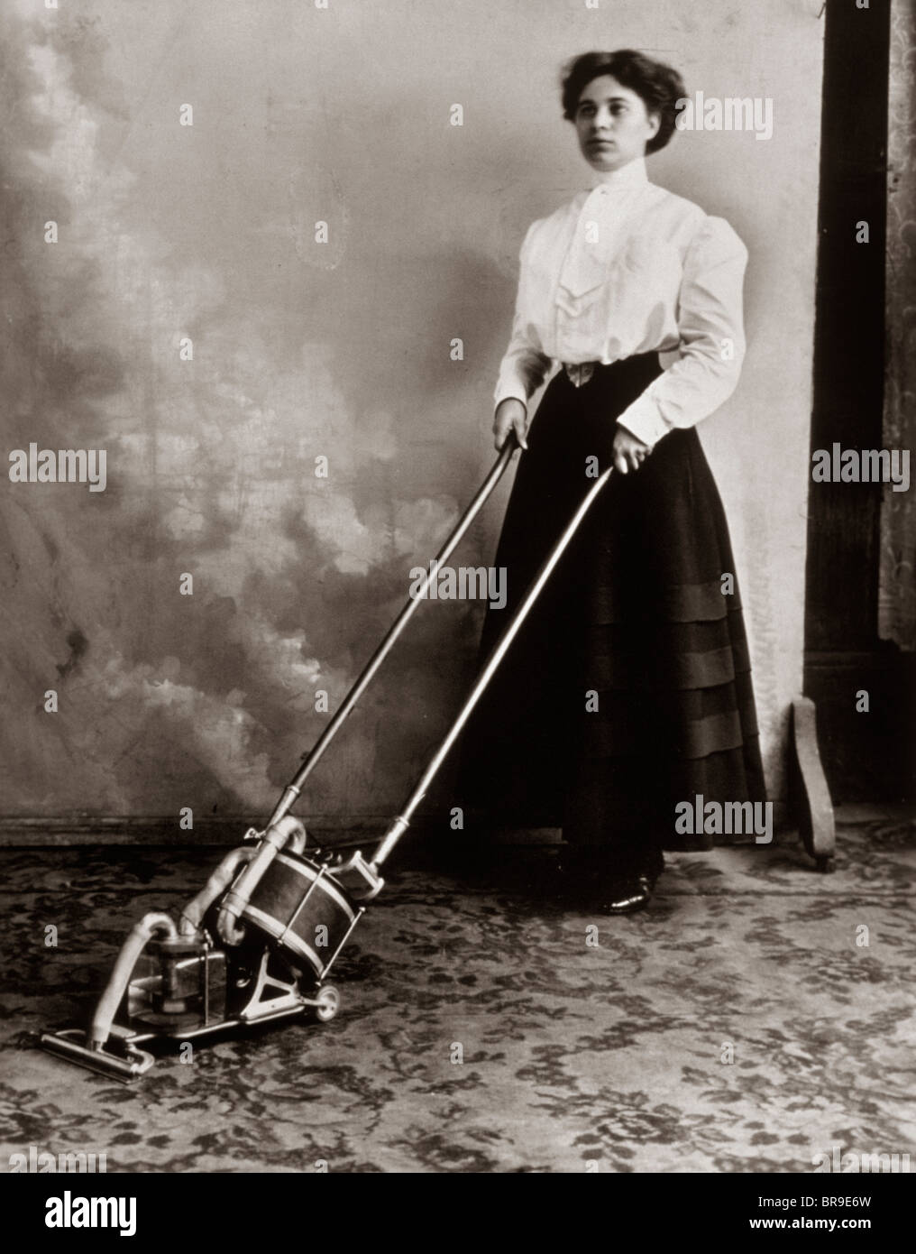 1900s Woman Using Vacuum Cleaner Stock Photo 31556193 Alamy