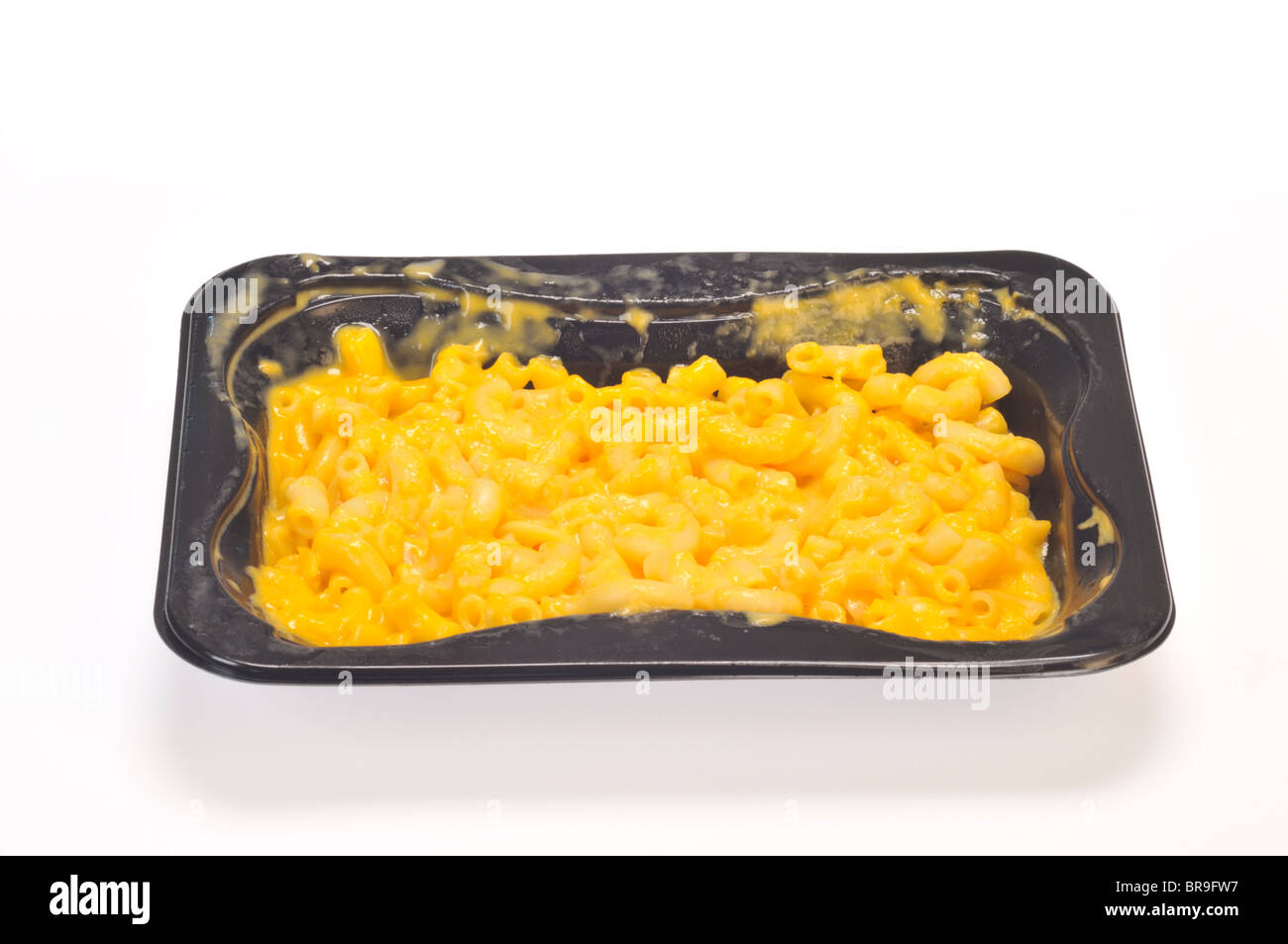 Tray of cooked macaroni and cheese on white background cutout - Stock Image