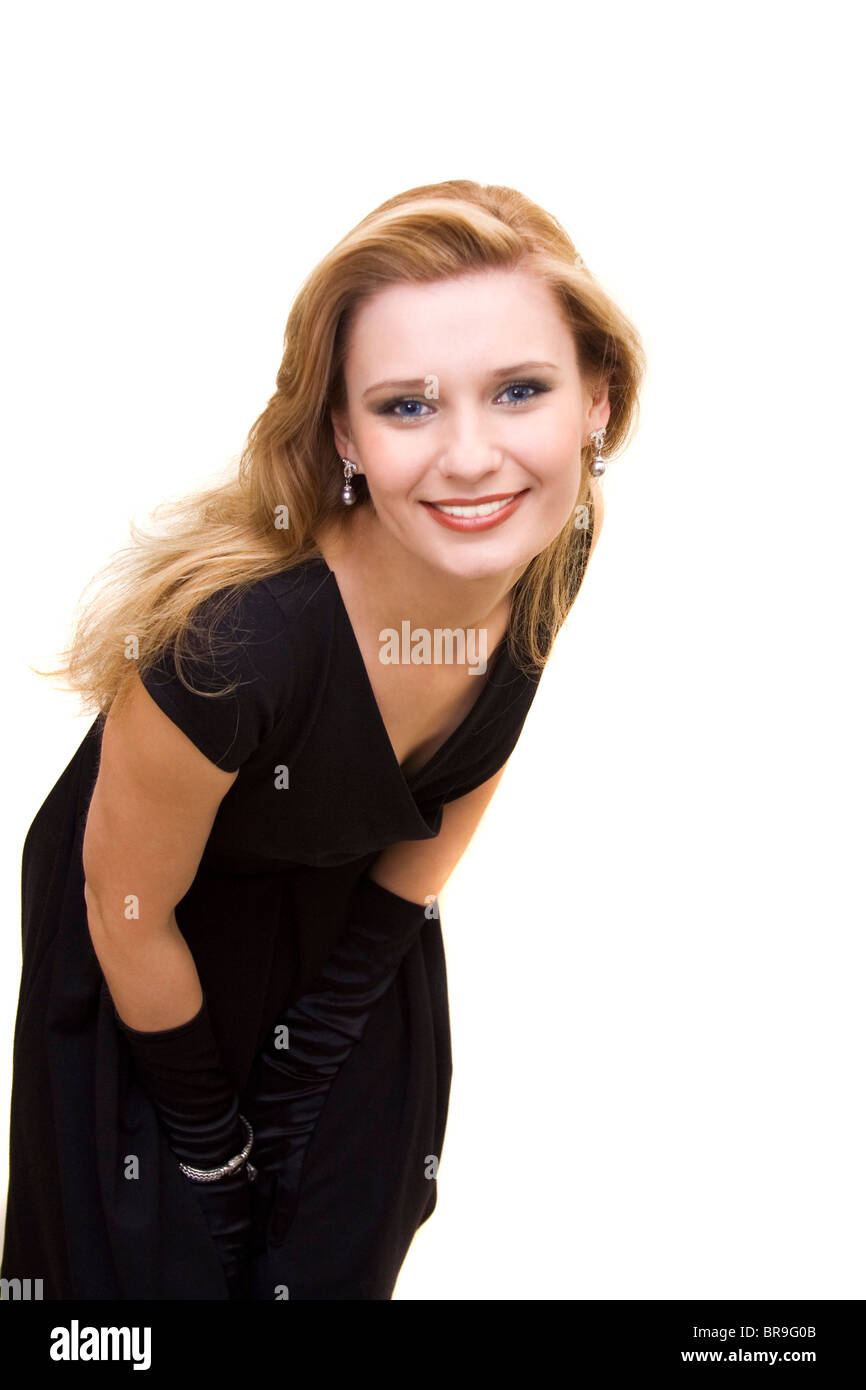 Blond attractive woman in black dress - Stock Image